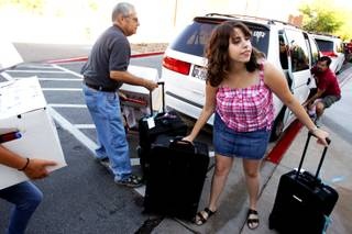 Alana Solomon, 18, a freshman from Las Vegas, gets ready to move into Tonopah Complex with her father Paul during residence hall move-in day at UNLV in Las Vegas on Thursday, August 23, 2012. Solomon is a CCSD housing scholarship recipient.