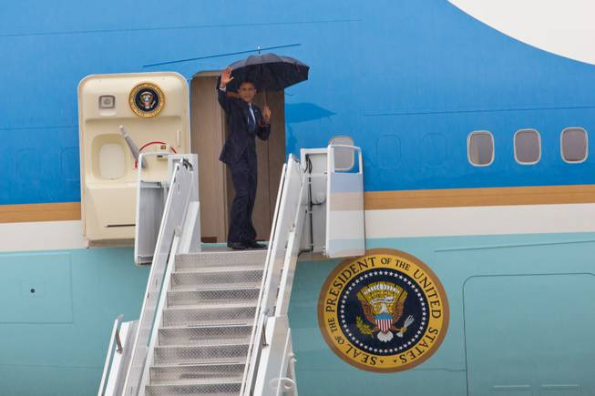 President Obama waves as he boards Air Force One to depart Las Vegas from Nellis Air Force Base, Wednesday, Aug. 22, 2012.