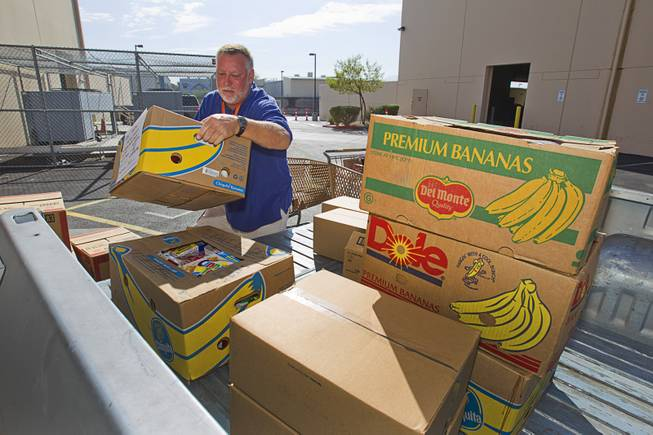 Tony Voggetzer of Sunrise Baptist Church loads food into a pick-up truck at the Three Square Food Bank Thursday, Aug. 23, 2012. The church's food pantry, which started in a deacon's closet, has already distributed 672,308 lbs. of food this year, according to Three Square records.