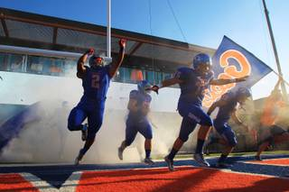 The Bishop Gorman footabll team takes to the field for their season opener against Our Lady of Good Counsel Friday, August 24, 2012.