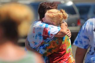 Dolores and Trisha Mootz, the mother and sister of missing teen William Mootz, embrace after the body William was found Friday, August 24, 2012. William Mootz was swept away by storm run off in the Pittman Wash during rainstorms on Wednesday.