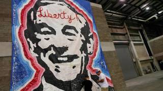 People were able to write love notes to Ron Paul on a giant poster of the candidate with the word Liberty scrawled across his forehead on display at P.A.U.L Fest Saturday, Aug. 25, 2012, at the Florida State Fairgrounds.