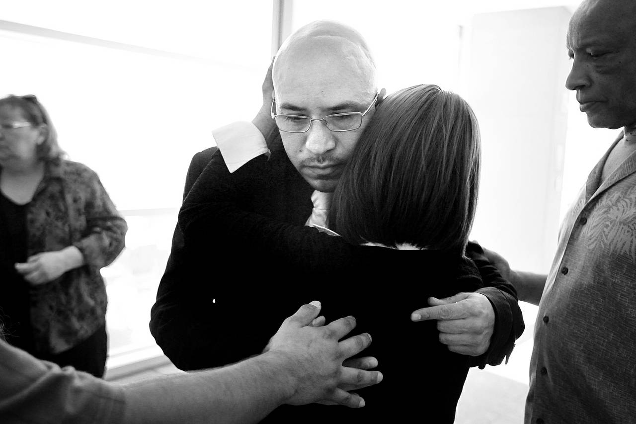 Arturo Martinez-Sanchez is consoled by his family and friends Aug. 27, 2012, after attending a Bryan Clay hearing at the Regional Justice Center in Las Vegas. Clay is the accused killer of Martinez-Sanchez's wife and daughter.
