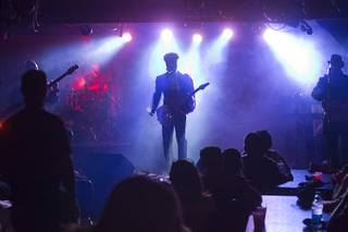 Prince impersonator Jason Tenner performs in his show Purple Reign at The D showroom in downtown Las Vegas Sunday, Aug. 26, 2012.