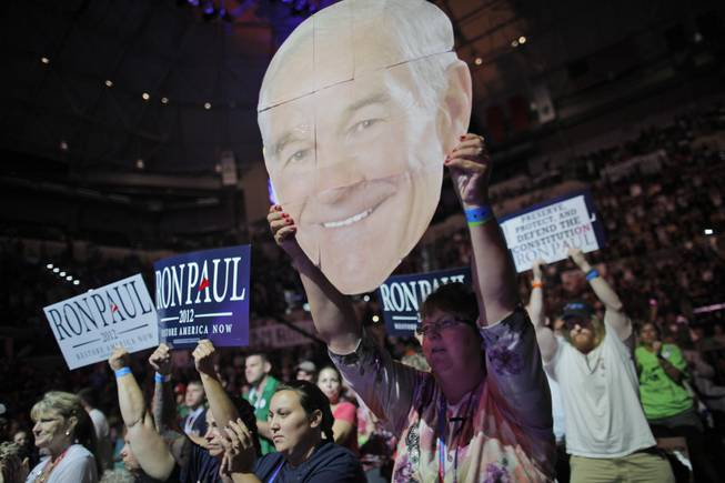 Mary White of Rathdrum, Idaho, shows her support for Rep. Ron Paul, R-Texas, at a rally at the University of South Florida Sun Dome on the sidelines of the Republican National Convention in Tampa, Fla., on Sunday, Aug. 26, 2012.