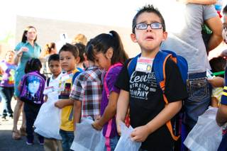Kindergartner Jonathan Mondragon sobs while standing in line on the playground prior to the first day of class Monday, August 27, 2012, at Cambeiro Elementary School in Las Vegas.