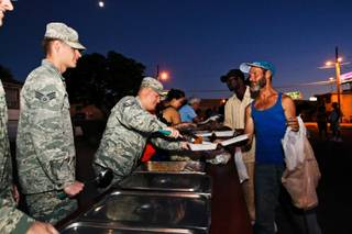 Master SSgt Brian LeClair serves chili mac' to the homeless attending the weekly outside soup kitchen organized by Nellis Air Force Base airmen at the intersection of G Street and West McWilliams Avenue in Las Vegas Monday, August 27, 2012.