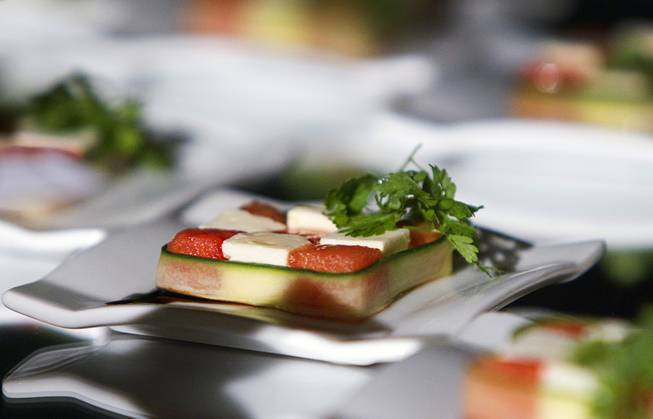 An dish with watermelon and feta cheese is displayed during ...