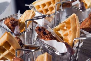 Baskets of fried chicken and waffles with syrup dispensers are displayed during a media preview of Bacchanal Buffet under construction at Caesars Palace on Tuesday, Aug. 28, 2012. Caesars hopes the $17 million, 25,000-square-foot buffet will set the new standard for Las Vegas buffets with more than 500 food items and seating for 600 guests.