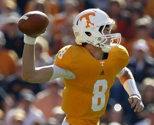Tennessee quarterback Tyler Bray (8) passes in the first quarter of an NCAA college football game against Mississippi on Saturday, Nov. 13, 2010 in Knoxville, Tenn. Bray passed for 323 yards and three touchdowns as Tennessee won 52-14.
