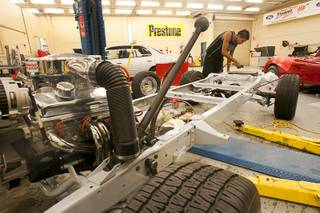 Julien Fontenot, a senior at the Southeast Career and Technical Academy in Henderson, works on a 1957 Chevrolet pick-up truck during a auto repair class at the school Wednesday, Aug. 29, 2012.
