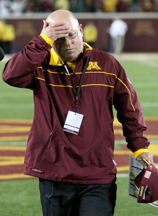 Minnesota coach Jerry Kill leaves the field after losing to North Dakota State 37-24 on Saturday, Sept. 24, 2011, in Minneapolis. Kill went 3-9 in his first season with the Gophers and opens his second season at UNLV at 8 p.m. on Thursday, Aug. 30, 2012.