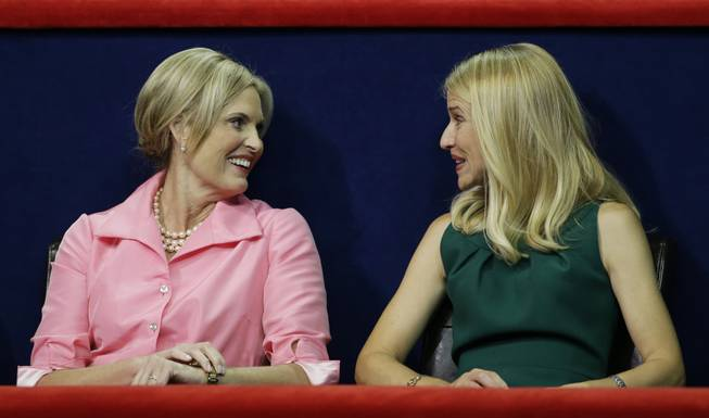 Ann Romney, left, wife of U.S. Republican presidential nominee Mitt Romney, chats with Republican vice presidential nominee Paul Ryan's wife, Janna, during the Republican National Convention in Tampa, Fla., on Wednesday, Aug. 29, 2012.