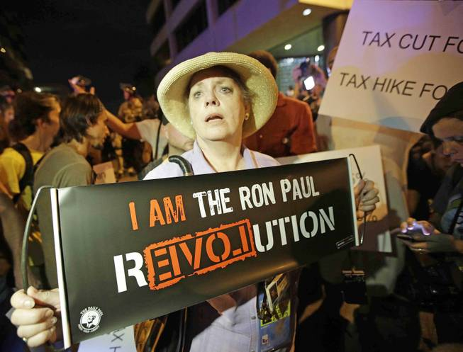 Ron Paul delegate Cynthia Kennedy of Nevada speaks during a protest, Wednesday, Aug. 29, 2012, in Tampa, Fla. Protestors gathered in Tampa to march in demonstration against the Republican National Convention.