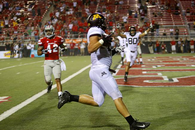Minnesota's John Rabe scores in the second overtime period during UNLV's season opener at Sam Boyd Stadium Thursday, Aug. 30, 2012.