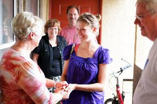 Kaitlyn Ferguson, an intern pastor from Minnesota, greets the welcoming committee when she arrives at her new apartment in Las Vegas on Friday, August 31, 2012. Ferguson will serve as an intern pastor for a year at the New Song Church in Henderson.