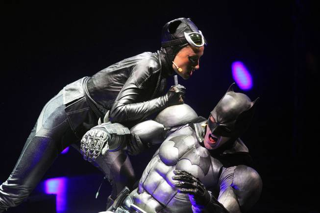 "Emma Clifford performs as Catwoman, left, and Sam Heughan performs as Batman during a technical rehearsal for ""Batman Live"" at the Thomas & Mack Center in Las Vegas on Friday, August 31, 2012. The show will run at the Thomas & Mack Center from October 3-7."