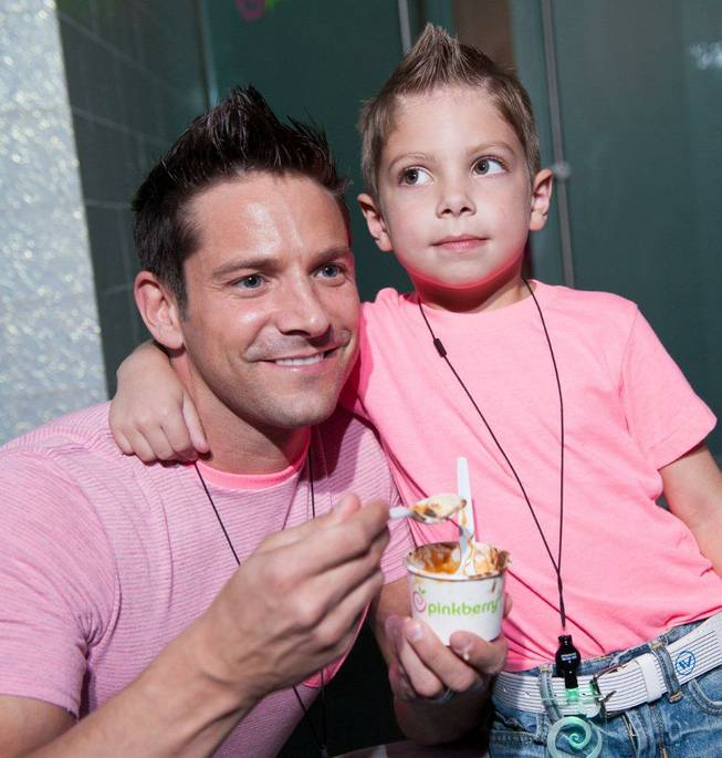 Jeff Timmons and his son attend the Pinkberry opening at Crystals in CityCenter on Thursday, Aug. 30, 2012.