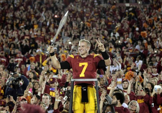 In this Nov. 26, 2011 file photo, Southern California quarterback Matt Barkley celebrates the Trojans' 50-0 win over UCLA in an NCAA college football game in Los Angeles.