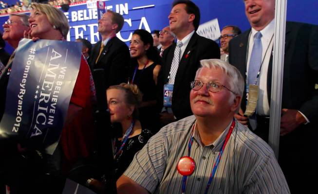 Washoe County GOP chairman David Buell, surrounded by the Nevada delegation, watches the Jumbotron during Mitt Romney's speech at the Republican National Convention in Tampa Thursday night on Aug. 30, 2012.