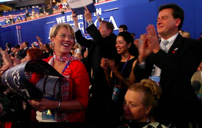 Nevada delegate Kim Bacchus and Lieutenant Governor Brian Krolicki exchange a glance and a smile during Mitt Romney's speech to the Republican National Convention Thursday night Aug. 30, 2012 in Tampa.