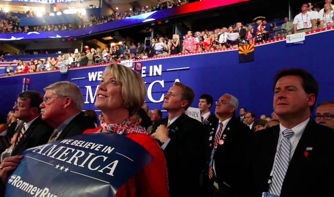 Nevada delegate Kim Bacchus and Lieutenant Governor Brian Krolicki look on during Mitt Romney's speech to the Republican National Convention Thursday night Aug. 30, 2012 in Tampa.