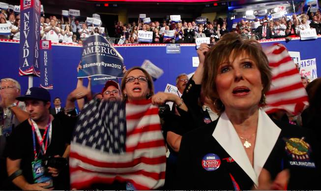 "Women from the Oklahoma delegation, across the aisle from Nevada's, join in a ""Mitt, Mitt, Mitt"" cheer during Mitt Romney's speech at the Republican National Convention Thursday night on Aug. 30, 2012."
