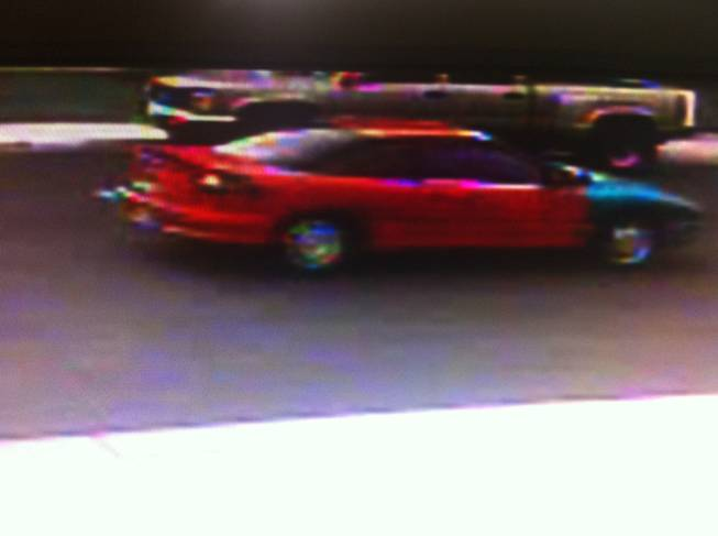 Police say suspects in a kidnapping in Henderson fled in this red, late model, two-door passenger car with a blue fender on the front passenger side.
