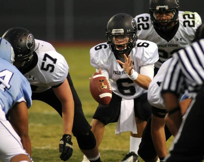 Palo Verde quarterback Parker Rost prepares to take a second half snap against host Centennial on Friday night.
