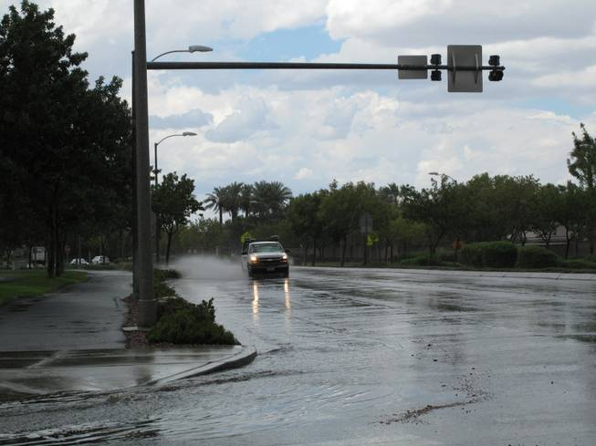 Palo Verde Drive near Green Valley Ranch quickly flooded after a storm passed over Henderson on Friday afternoon, Aug. 31, 2012.