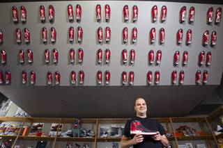 Collector Jordan Michael Geller poses in the ShoeZeum at the Neonopolis mall in downtown Las Vegas Sept.1, 2012. The collection has 2,500 pairs of new Nike shoes.