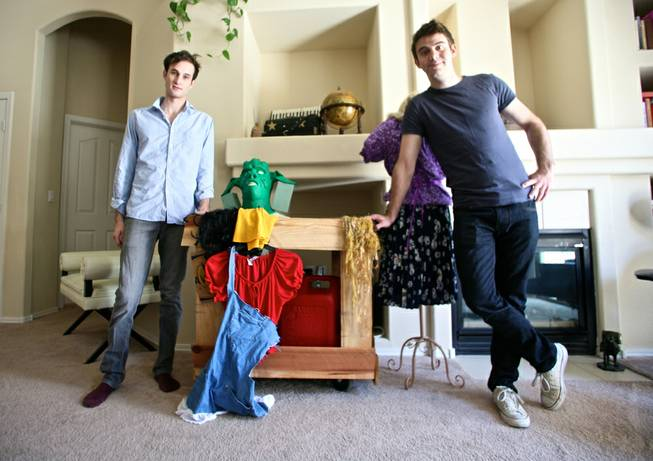 "Spencer Novich (left) and Brett Alters pose with props and costumes for their original production ""Two Little Girls in the Bayou."" The pair used the crowd-funding website Kickstarter to raise $10,000 for the production."