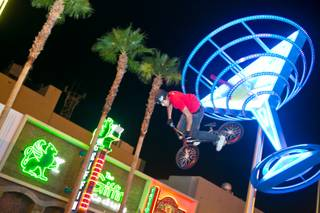 BMX pro Ricardo Laguna performs a jump trick during the Jump for Joy BMX fundraiser in front of InsertCoin(s) Videolounge Gamebar, Monday Sept. 3, 2012.