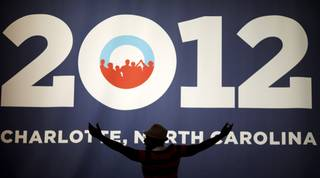 Chris Jones of Charlotte poses in front of the campaign sign as his friend takes a picture at the Democratic National Convention in Charlotte, N.C., on Tuesday, Sept. 4, 2012.