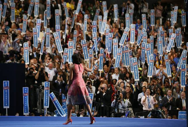 First Lady Michelle Obama waves after addressing the Democratic National Convention in Charlotte, N.C., on Tuesday, Sept. 4, 2012.
