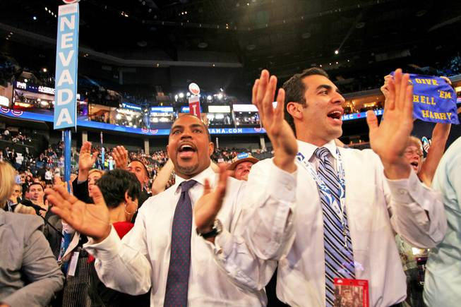 State Sens. Steven Horsford and Ruben Kihuen, both Nevada delegates, cheer for Sen. Harry Reid after his speech at the Democratic National Convention in Charlotte, N.C. Tuesday night.