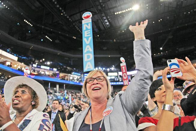 Nevada delegation Chairwoman Roberta Lange cheers and waves at Sen. Harry Reid as he takes the stage to deliver his speech to the Democratic National Convention in Charlotte, N.C., Tuesday night.