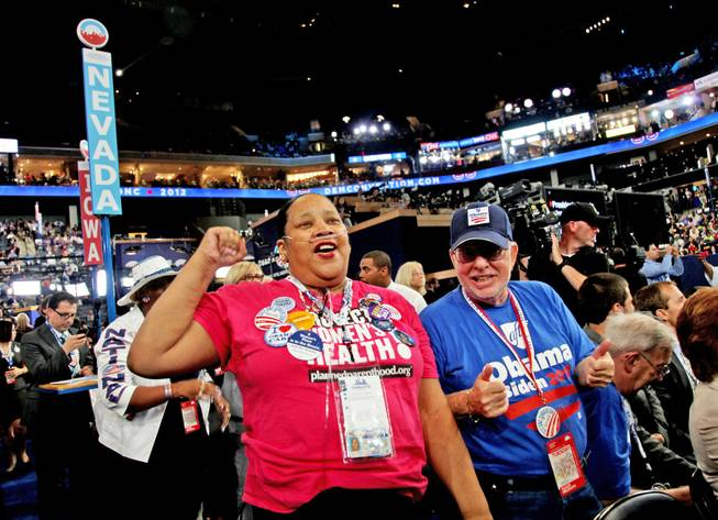 Nevada delegates Edith Byrd and Richard Miller cheer Sen. Harry Reid after his speech to the Democratic National Convention in Charlotte, N.C., Tuesday night.