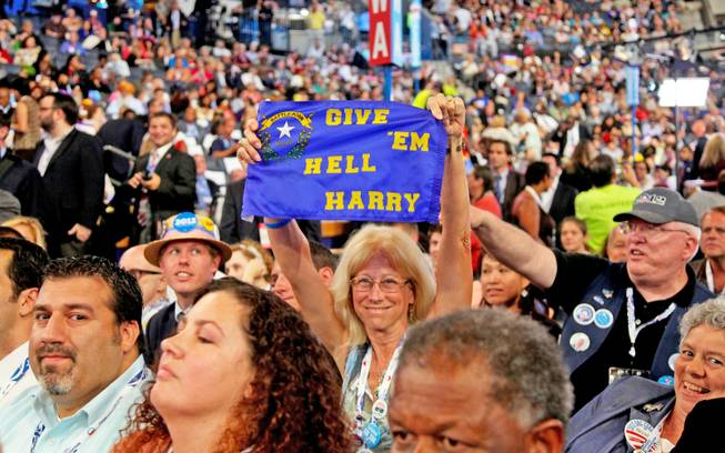 Laurie Haley, treasurer of the Washoe County Democratic Party, holds up a cloth sign she brought to cheer on Sen. Harry Reid during his speech to the Democratic National Convention in Charlotte, N.C., Tuesday night.