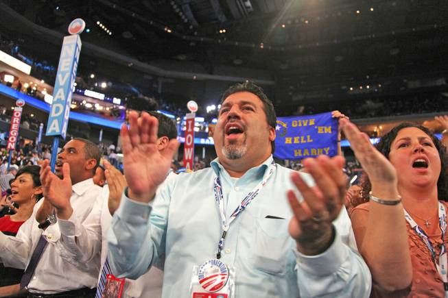 Andres Ramirez, a Democratic political consultant and Nevada delegate, cheers for Sen. Harry Reid after his speech to the Democratic National Convention in Charlotte, N.C. Tuesday night.
