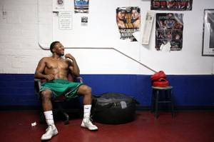 Lydell Rhodes, 24, of Las Vegas takes a break while training at Johnny Tocco's Boxing Gym in downtown Las Vegas on Wednesday, September 5, 2012.