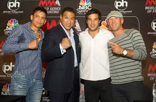 World Series of Fighting league president Ray Seto, second left, poses with fighters during a news conference at the Planet Hollywood Live theater (formerly the Theatre for the Performing Arts) at Planet Hollywood Thursday, Sept. 6, 2012. From left are: Miguel Torres, Seto, Gregor Gracie, and Josh Burkman. The new league will debut with a fight card broadcast on NBC at the theater on Nov. 3.