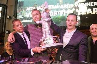 DJ Calvin Harris, center, celebrates his two 2012 MTV Video Music Awards wins at XS in the Encore with Jesse Waits and Sean Christie.
