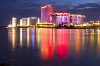 Laughlin casino lights are reflected in the Colorado River at sunset Sunday, Sept. 9. 2012.