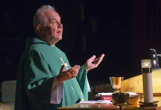 Father Charlie Urnick, of St. John the Baptist Catholic Church, conducts Mass at the Riverside Casino in Laughlin Sunday, Sept. 9. 2012. The church is the only Catholic church that holds weekly Mass in a casino, Urnick said.