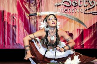 Silvia Salamanca from Mallorca, Spain, holds poses while balancing swords at the 10th Annual Bellydance Intensive & Festival that took place the weekend of Sept. 6, 2012.