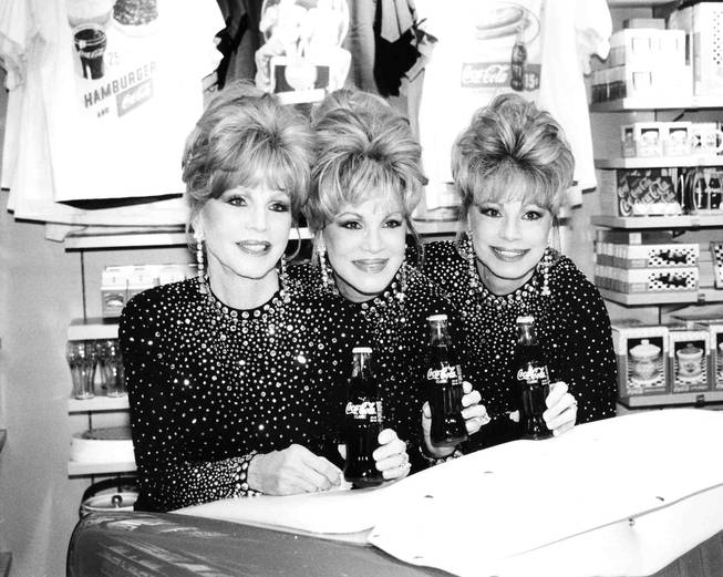 The McGuire Sisters attend the opening of the World of Coca-Cola on the Strip on July 7, 1997.