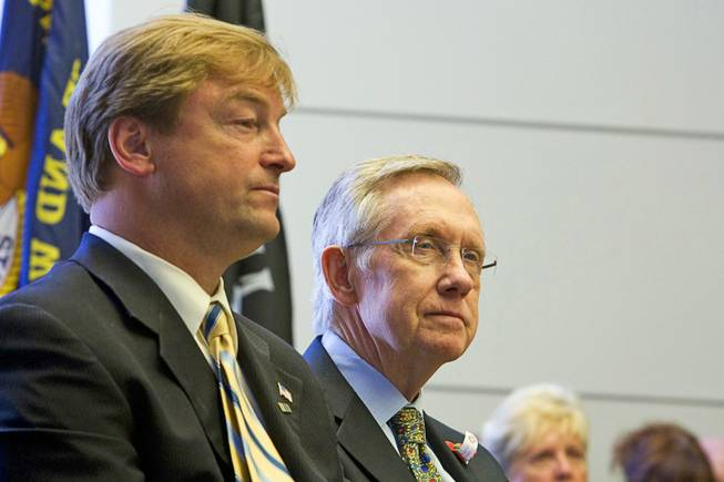 Sens. Dean Heller, left, and Harry Reid attend a Memorial Day ceremony in Boulder City on May 30, 2011.