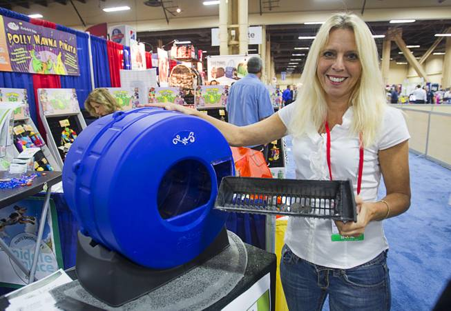 Ann Jolie, COO of Smart Choice Pet Products, demonstrates the Litter Spinner, a quick-cleaning cat litter box, during SuperZoo, a trade show for the pet industry, at the Mandalay Bay Convention Center Tuesday, Sept. 11, 2012.