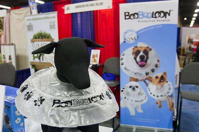A BooBooLoon Protective Petwear recovery collar is displayed during SuperZoo, a trade show for the pet industry, at the Mandalay Bay Convention Center Tuesday, Sept. 11, 2012. The inflatable pet collar is more comfortable than hard cones and other rigid collars.